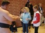 former U.S. Sumo champion Troy Collins and 5-time U.S. Sumo champion Dan Kalbfleisch sign autographs