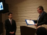 Mark Harmsen of Congressman Dreier's office presents a certificate to outgoing Mayor Mosca