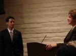 Rita Hadjimanoukian presents Mosca a certificate on behalf of Supervisor Antonovich