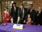 New Mayor Buchanan and the Council cut the cake at the post-meeting reception