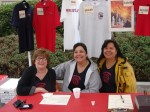 Firefighter wives Lynette Heydorff, Roxie Bartlett and Laura Snyder (wo)manned the merchandise booth