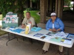 Bruce Inman and Elaine Aguilar at a table promoting City services that was near, but not at, the Town Hall Forum