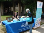 "Resident gets literature at City sponsored ""Energy Upgrade"" table"