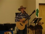 Mike Tims of Sierra Madre performed country music for the audience