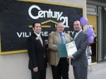 Bencosme, Ludecke and Moran with certificate from the City recognizing Village Realty's 25th anniversary