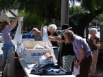 Civic Club volunteers prep the check-in items for pre-registration
