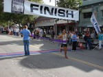 25-year old Victor Rios of La Puente crosses the finish line first at Mt. Wilson Trail Race