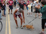 Immediately after crossing the finish line, Lono stops to acknowledge a friend.