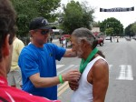 Trail Race chair Pete Siberell presents Lono with the 2011 Race medal