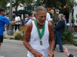 Lono wearing medal from 2011 Trail Race