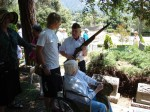 Bud Switzer shows his grandson around the rifle as Donna May Switzer looks on