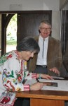 Council member MaryAnn MacGillivray and husband Duncan sign commemorative photo, photo courtesy of Mountain Views News