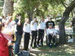 Veterans salute during National Anthem