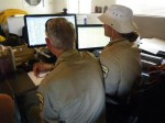 SMSR team members monitor GIS software during Joshua Tree training exercise.  Photo courtesy of SMSR