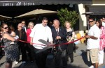Chef Sean Roache and Bill May cut the ribbon
