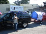 Board Member Allyn Colbert droves his Chevy Tahoe in the parade