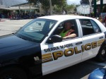 Officer Berry in the SMPD vehicle celebrating a 10 year anniversary - which means its the last parade for this car...