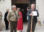 "Mayor Buchanan presents ""Notice to Proceed"" to Public Works Director Bruce Inman"