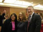 "City Manager Elaine Aguilar and Mayor John Buchanan ""bookend"" Toni Buckner"