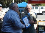 Assemblyman Tim Donnelly's rep. Steve Johnson presents State Assembly proclamation to Team Pres. Larry Smith