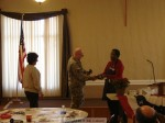 "Sgt. Major Koontz receives a ""token"" gift from Kiwanis Pres. Susan Henderson"