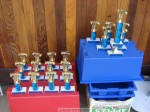 Top finishers in each division got trophies