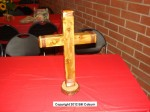 The featured auction item was a cross made from the wood of the recently removed pepper tree in Kersting Court, made by Joe Pergola
