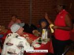 Kiwanis Pres. Susan Henderson sells 50/50 raffle tickets