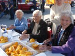 """Snookie Greger, Jan O'Day and Marjorie """"Mama Pete"""" Peterson have been cutting oranges at the Trail Race for years."""