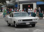 Ted Saraf and his restored police cruiser led off the parade
