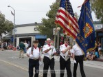 Members of the VFW Post 3208 color guard start the 2012 Parade