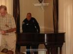 Officer Ken Berry plays a little piano