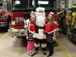 Santa with his assistants as they get ready to head downtown
