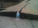 Bottle gives perspective to how much the street buckled