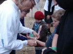 Civic Club volunteers helped the youngsters with their wrist bands