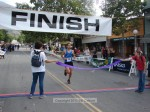Overall winner Eulogio Rodriguez, of Whittier, CA crosses the line at 1:00:32