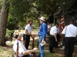 Council member Chris Koerber shakes hands with one of the veterans as Caldwell looks on