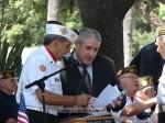 Commander Dave Loera confers with singer Peter Vecchio