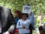 Resident Hilda Guzman holds up a picture of her nephew, Donald J. Cline, who was killed in Iraq ten years ago in April