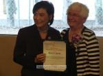 Congresswoman Chu presents Joan Crow with a proclamation