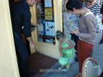 Kenny from Zugo's hands out candy to the little ones