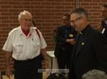 VFW Quartermaster Ted Evans and Monsignor Krekelberg of St. Rita